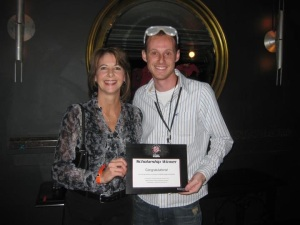 Kyle Clifton being presented with the Scholarship by ReSound's President, Kimberly Herman.