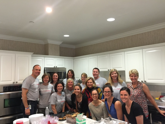 Employees from ReSound and Audiologists from Walter Reed National Military Medical Center serving a meal at Fisher House.